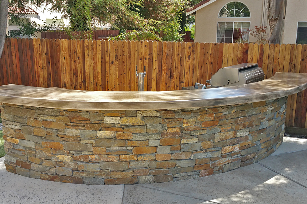 Oval Shaped rounded seating area bar outdoor kitchen